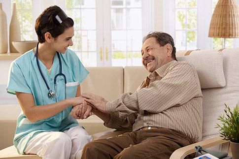 Female nurse caring for a senior male